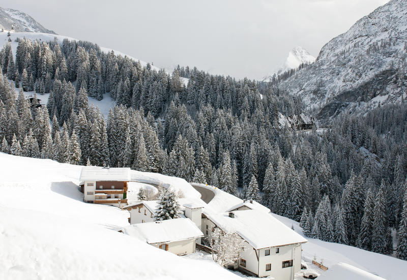 Austrian Winter Scene. Chalets on the side of a mountain, near the village of Warth-Schrocken, in Austria stock images