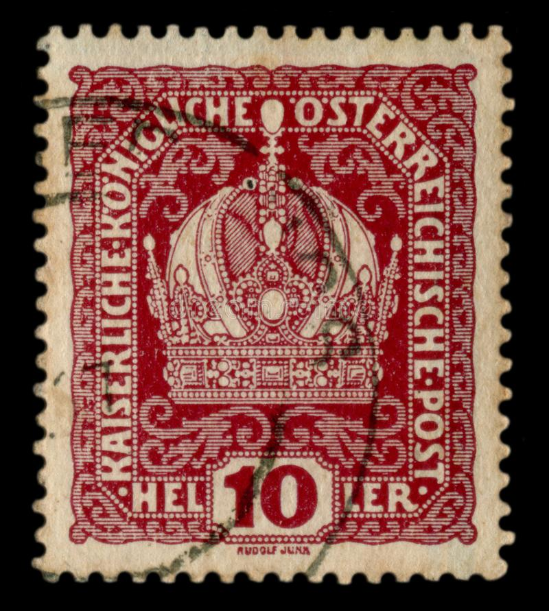 Austro-Hungarian Empire - circa 1914: Austrian historical stamp: Image of the Imperial crown with flower curls, cancellation, worl. D war one 1914. Austria stock image