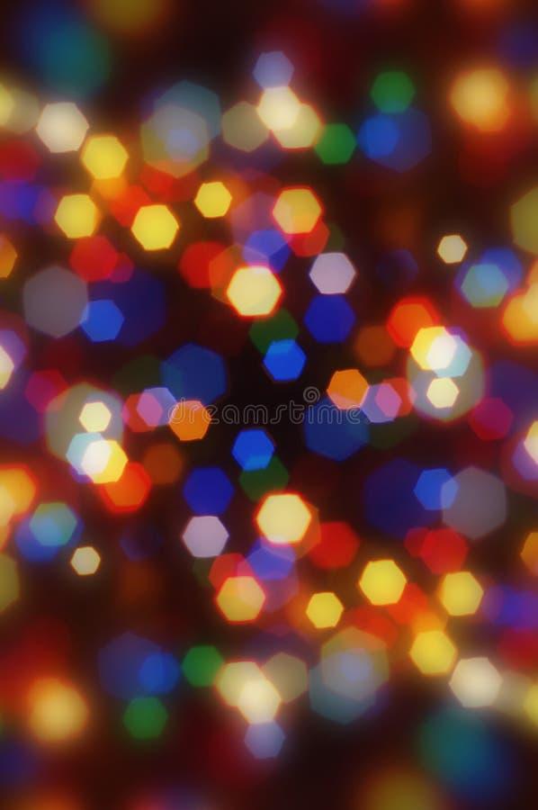 Auszug unscharfes buntes Weihnachtenbokeh. stockfotografie
