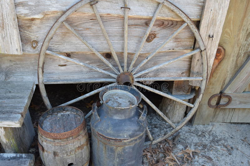 Antique Wagon Wheel and Water Barrels. At the Knap In Prehistoric Arts Festival in Ocala, Florida on Feb. 20, 2016 stock photography