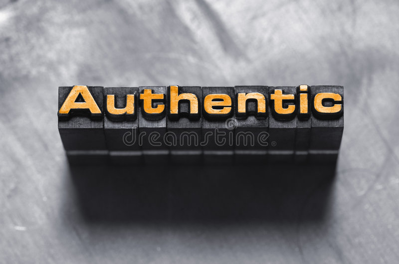 Authentic. The word Authentic photographed using vintage type charcters on a textured background. See my other portfolio for more vintage type images stock photo