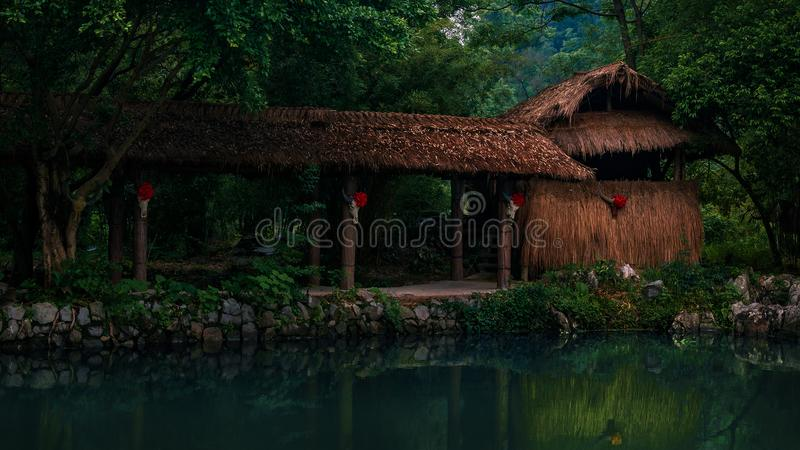 Authentic Authentic Chinese building on a hiking trail among trees next to Minority village at Yangshuo royalty free stock photos