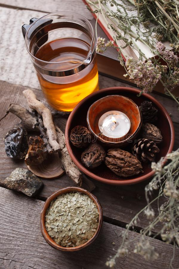 Authentic interior details, glass of herbal rea, dry herbal plants, homeopathic treatment on rustic wooden background, alternative. Medicine, healthy closeup royalty free stock images