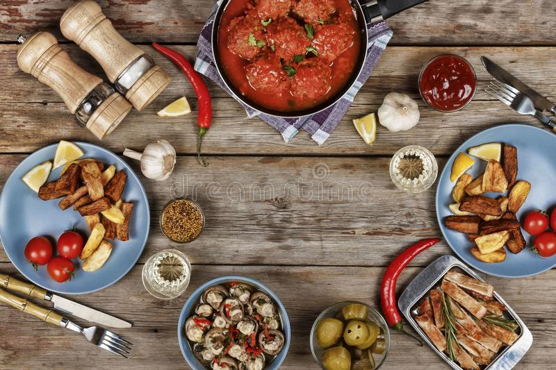 Authentic Italian meatballs, chips and other traditional snacks stock images