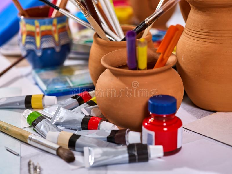 Authentic paint brushes still life on table in art class school. Authentic paint brushes still life on table in art class school as drawing course. Group of royalty free stock photos