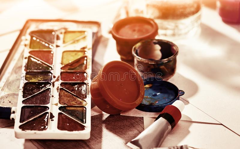 Authentic paint brushes still life on table in art class school. Authentic paint brushes still life on table in art class school as drawing course. Group of royalty free stock photo