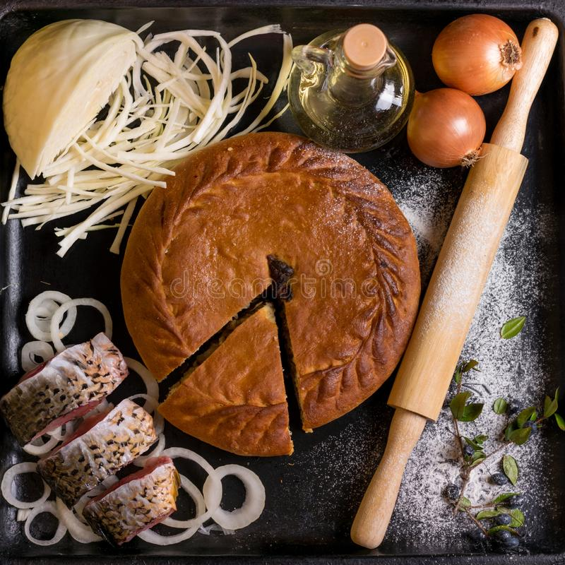 Authentic pie on a black background with ingredients stock images