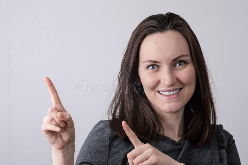 Authentic portrait of a young European woman , frontally in front of the camera royalty free stock photo