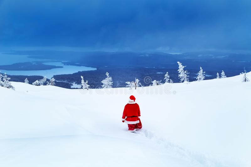 Authentic Santa Claus on a snowy mountain royalty free stock image