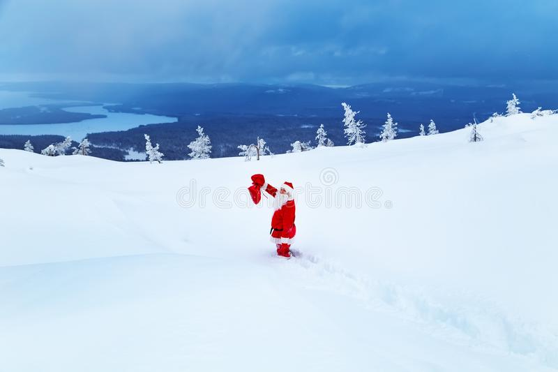 Authentic Santa Claus on a snowy mountain stock image