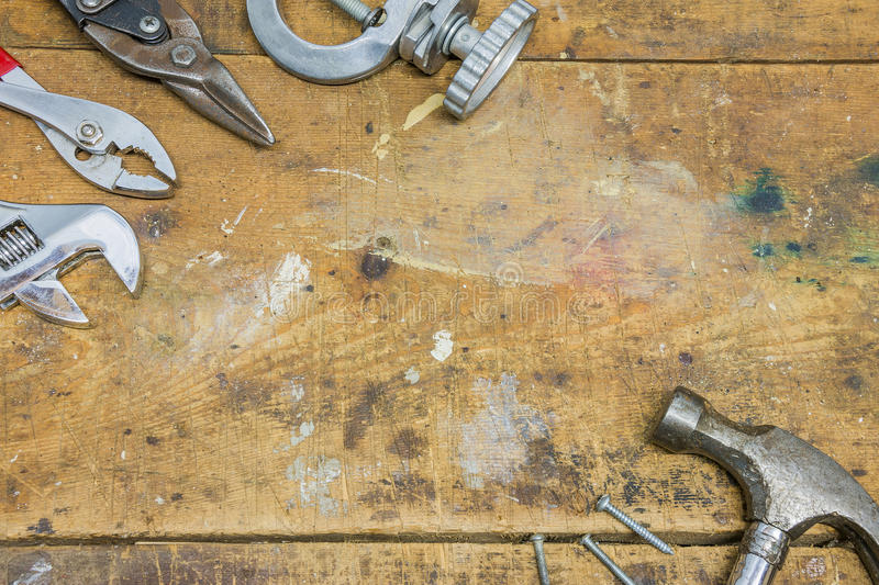 Authentic tools and workbench background border. Tools and workbench background border with hammer, wrench, pliers and screws stock image