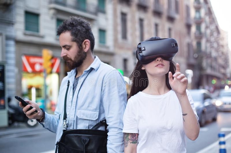 Couple or friends experience VR in the city stock photo