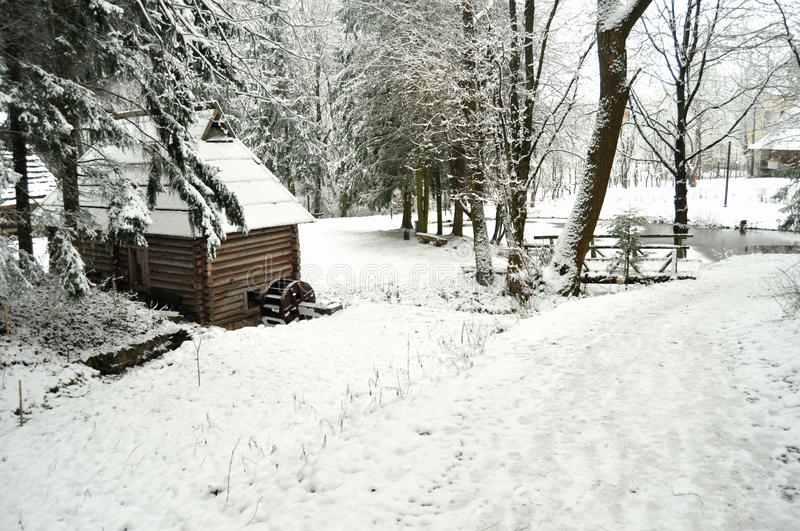 Authentic ukrainian village with wooden huts and fences in winter. royalty free stock image
