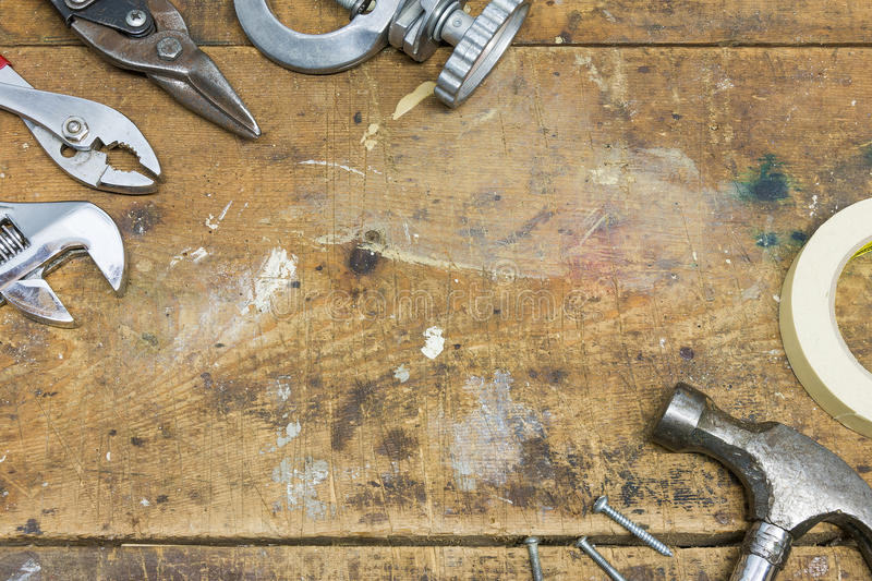 Authentic worn workshop bench background with various tools stock photo
