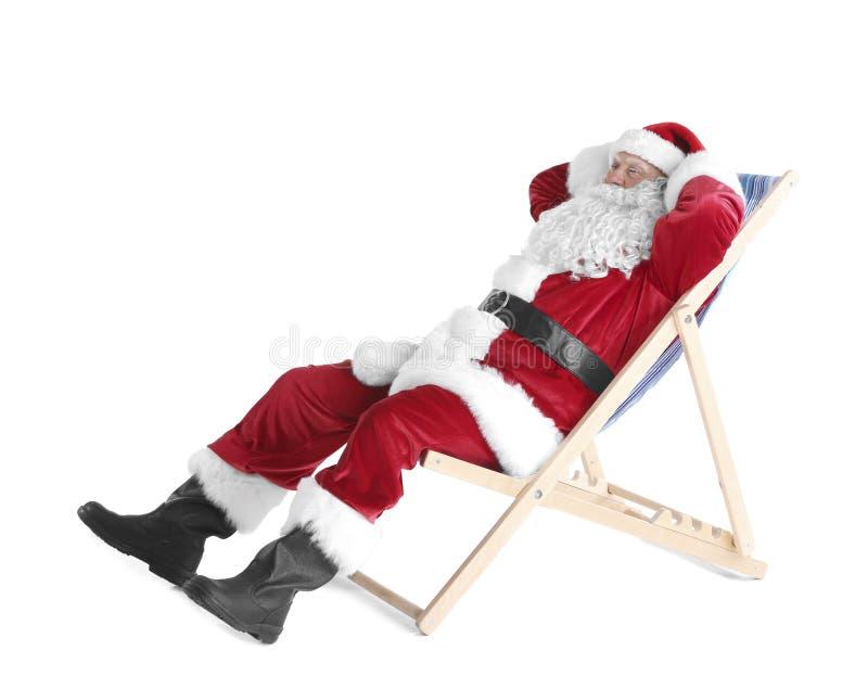 Download Authentieke Santa Claus-zitting Op Een Ligstoel Stock Foto - Afbeelding bestaande uit bejaarden, hoed: 107703440
