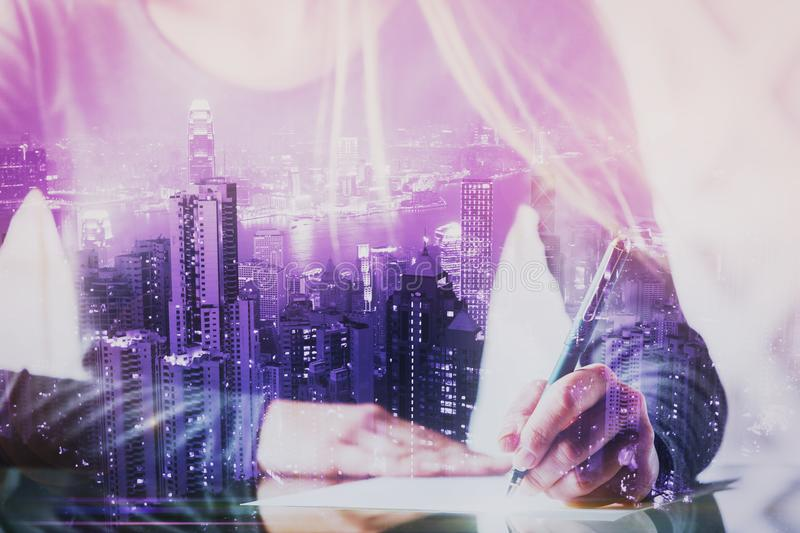 Author and job concept. Close up of businesswoman hands doing paperwork or writing letter at abstract desk with city view. Author and job concept. Double stock images
