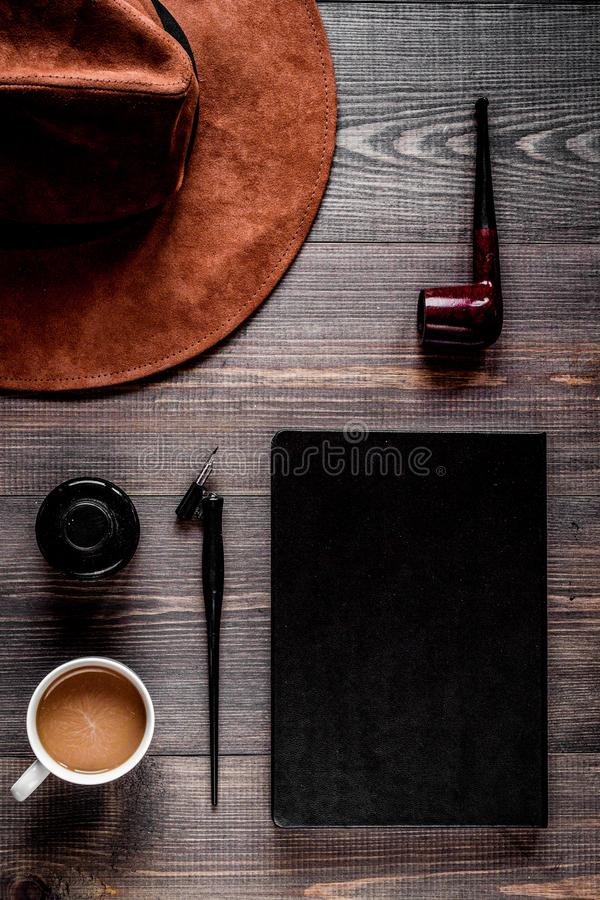 Author office in writer concept on desk background top view. Author office with hat and cup in professional writer concept on wooden work desk background top royalty free stock photography