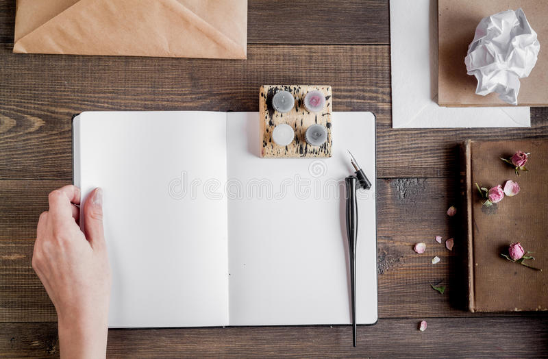 Author office in writer concept on desk background top view. Author office in professional writer concept with hands on wooden work desk background top view royalty free stock image