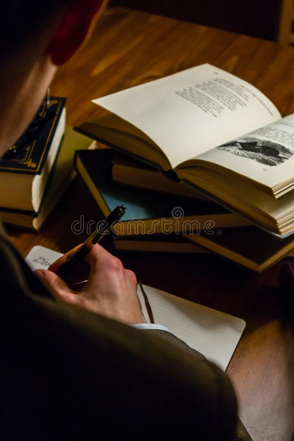 Man reading a writing about a book he is studying royalty free stock photography