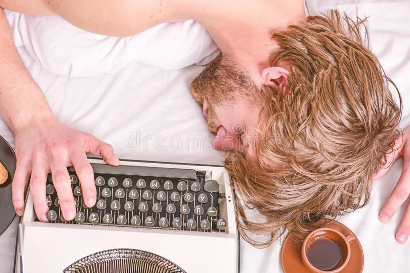 Author tousled hair fall asleep while write book. Workaholic fall asleep. Man with typewriter sleep. Deadline concept. Worked all night. Man fall asleep royalty free stock image