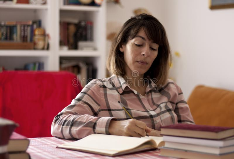Author writing a novel at home royalty free stock image