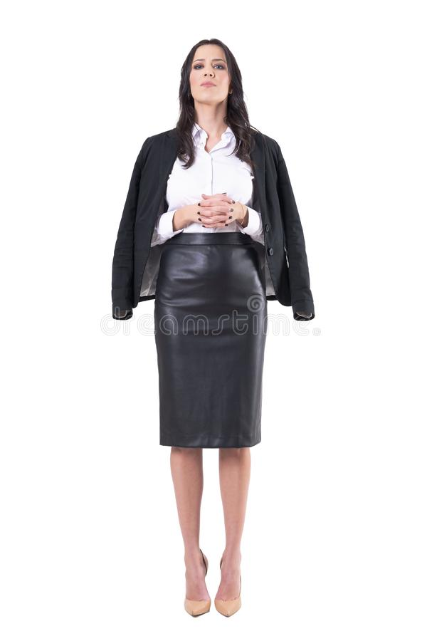 Authoritative bossy displeased business woman with interlaced finger staring at camera. Full body isolated on white background stock photos