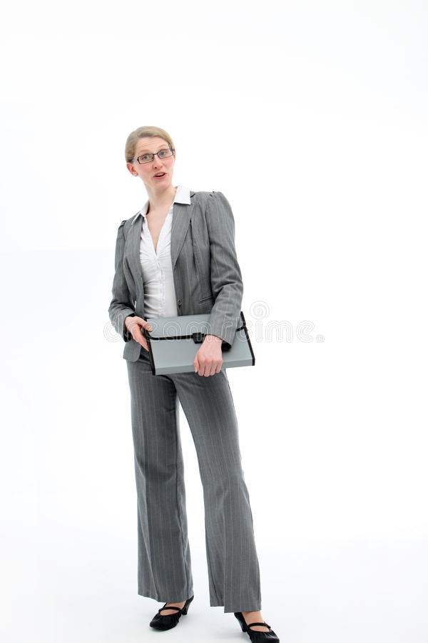 Authoritative confident businesswoman. Standing full length in a stylish slacksuit holding a folio file stock images