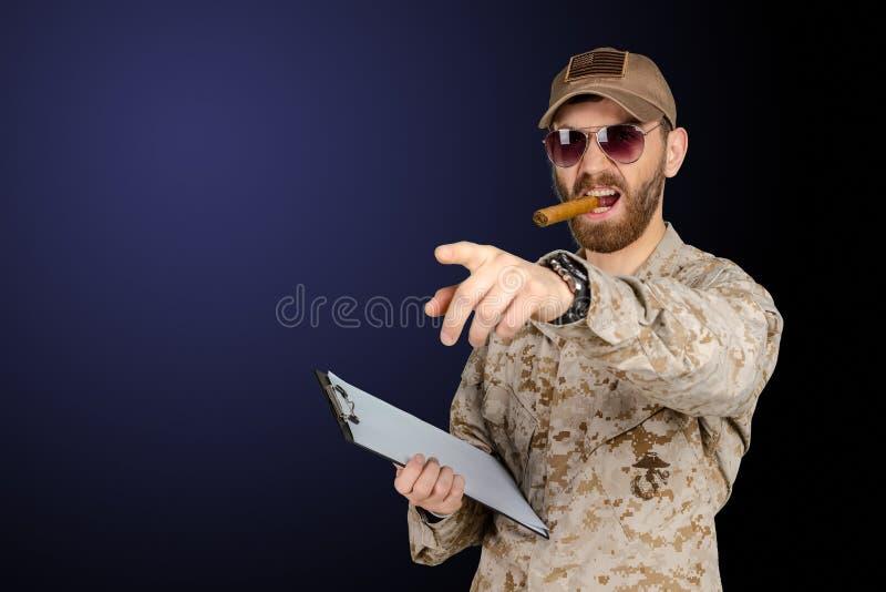 Authoritative military man. In uniform using cigar royalty free stock photo