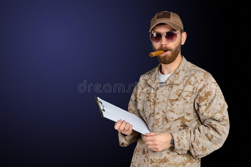 Authoritative military man. In uniform using cigar stock photo