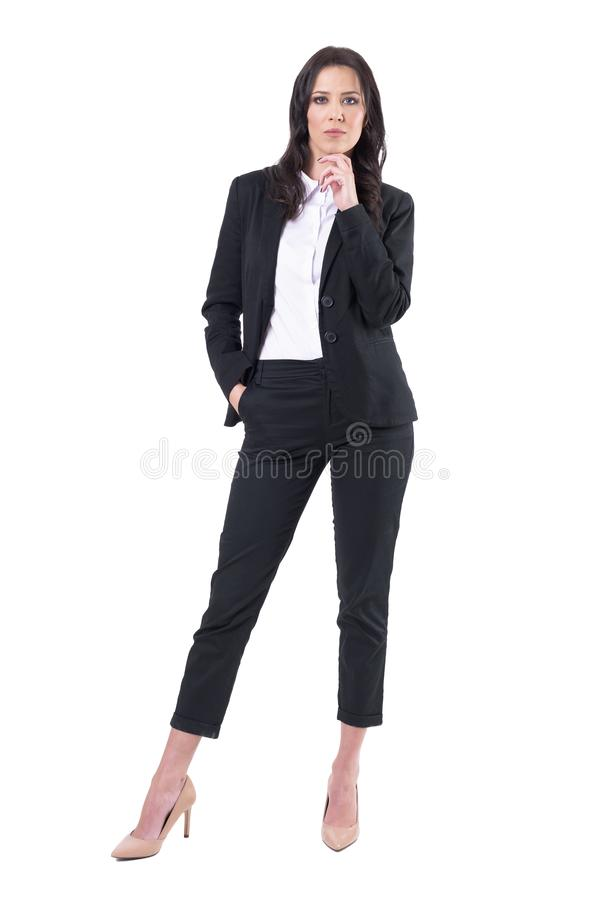 Authoritative successful female business entrepreneur looking at camera. Full body isolated on white background royalty free stock photography