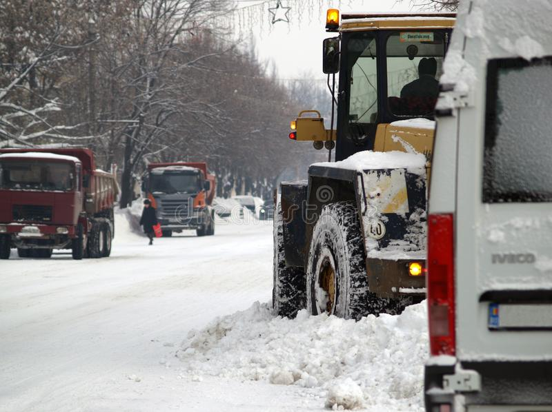 Authorities cleans the snowy roads. In Romania after a big snow royalty free stock photography