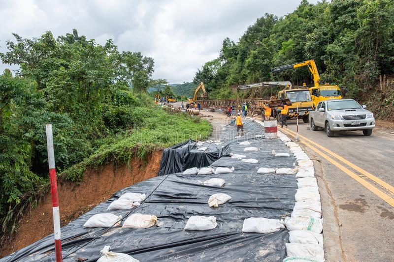 Authorities repairing the collapsed road landslide. Nan, Thailand - Aug 04 2018 : Authorities repairing the collapsed road landslide in valley royalty free stock photography