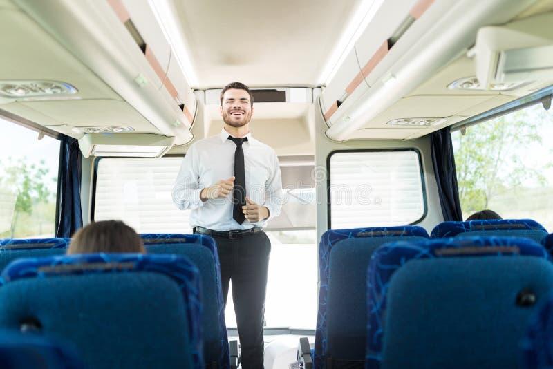 Autista di autobus sorridente In Formals fotografia stock