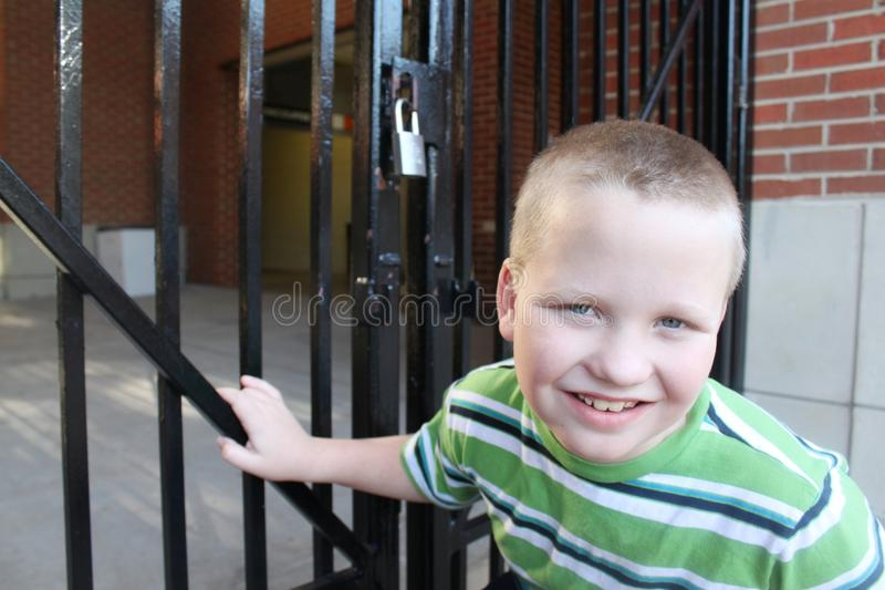 Autistic Boy At A Locked Gate Stock Images