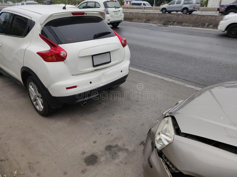 Auto accident involving two cars on a city street stock photo