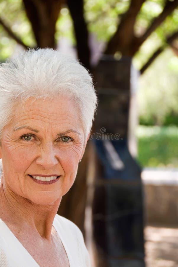 Auto assegurado, mulher madura imagens de stock royalty free