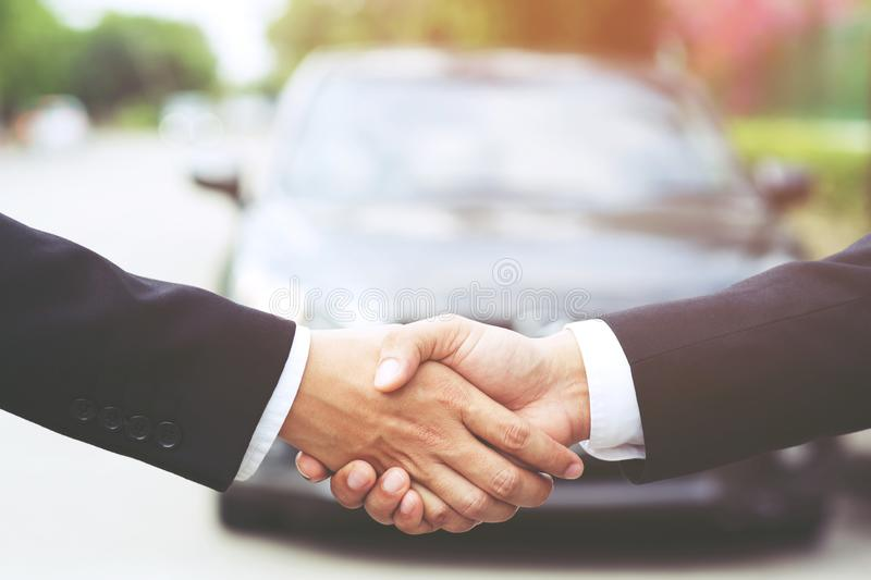 Auto business. Close up of a business man dealer offer car to new owner royalty free stock images