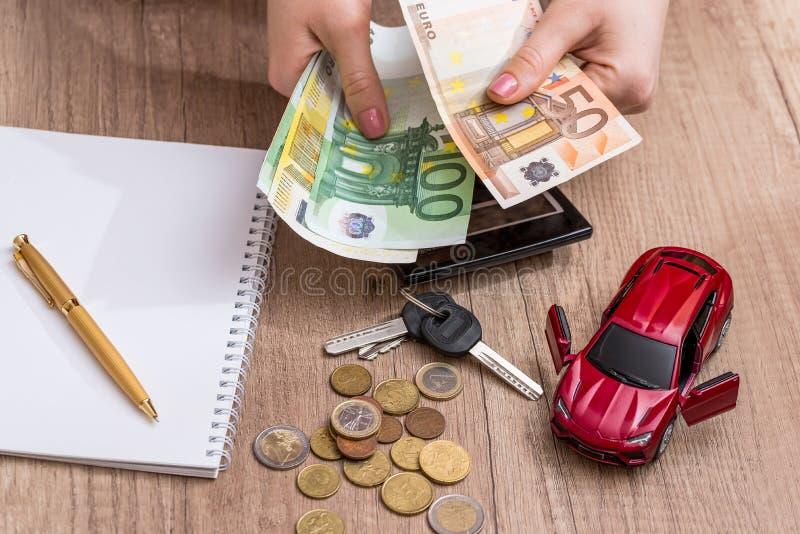 Auto concept. With euro, pen on desk royalty free stock photos