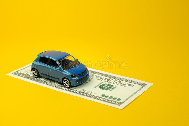 Auto dealership and rental car. Auto dealership and rental concept, new car buy. toy car dollar bill stock images