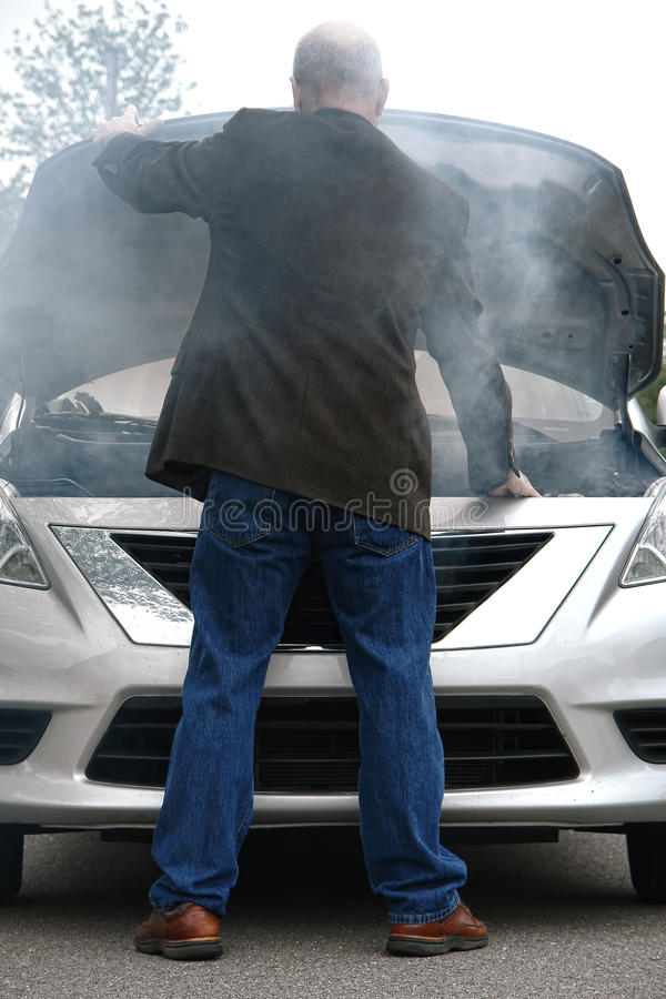 Auto Driver And Open Car Engine Hood In Fire Smoke Stock