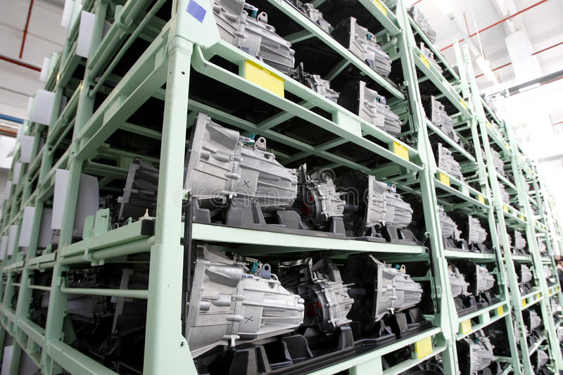 Auto Engines factory. Auto engines arranged on shelves in spare parts factory interior royalty free stock image