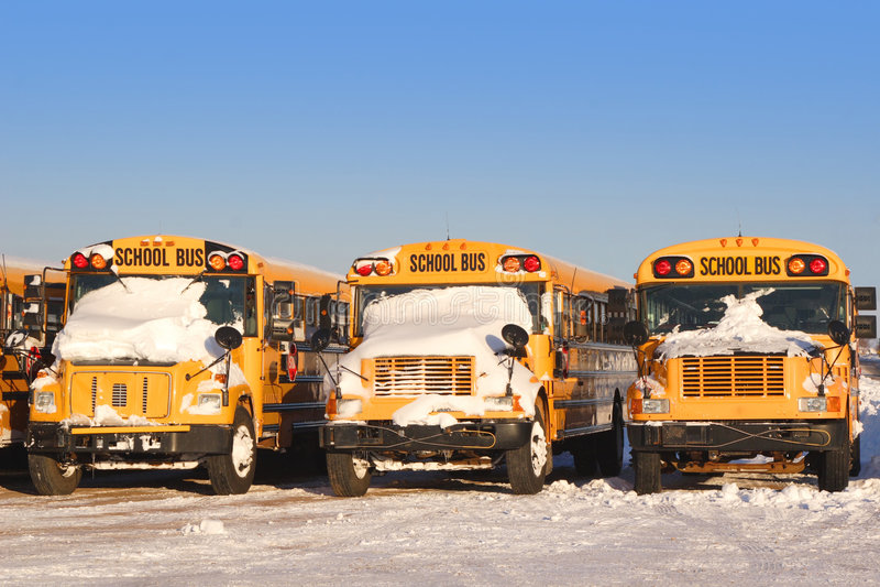 Auto escolares 2 do inverno fotografia de stock