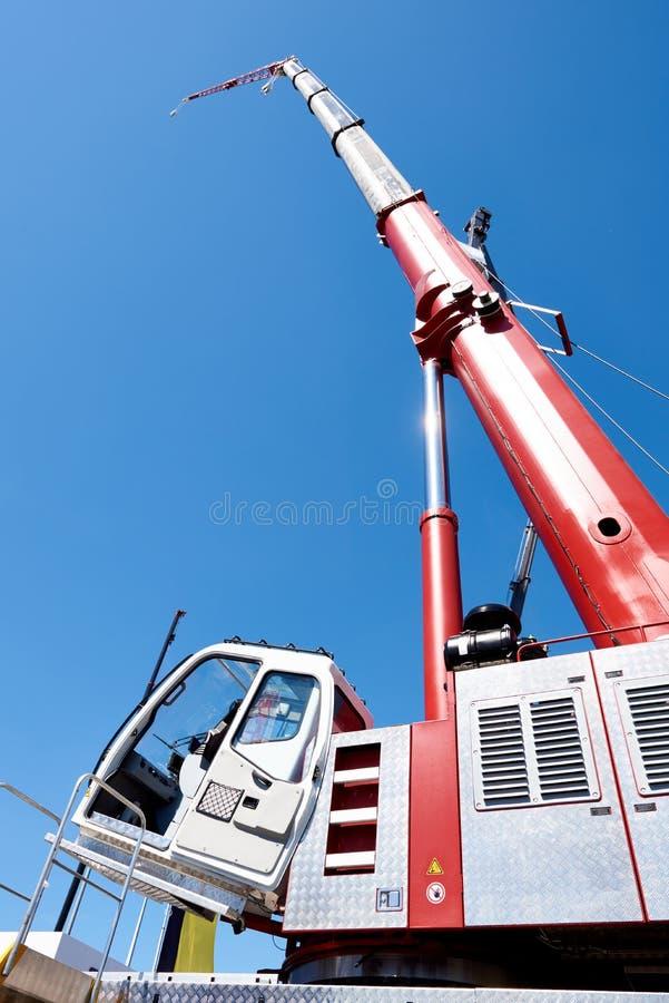 Auto hydraulic crane. Auto hydraulic lift crane on sky background royalty free stock photo