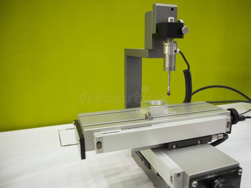 Auto measuring machine , CMM. Measuring dimension of precision part , auto probe touching royalty free stock photos