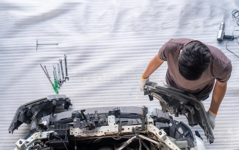 Auto mechanic is assembling car parts royalty free stock images