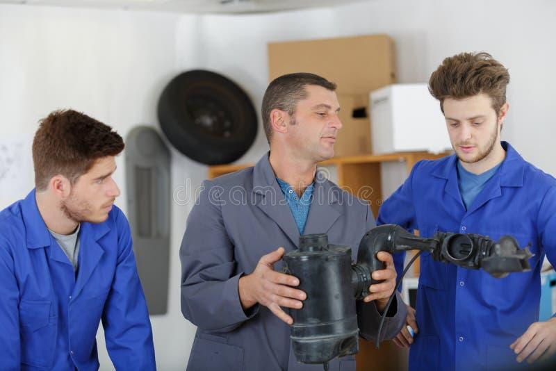Auto mechanic parts assembler royalty free stock photography