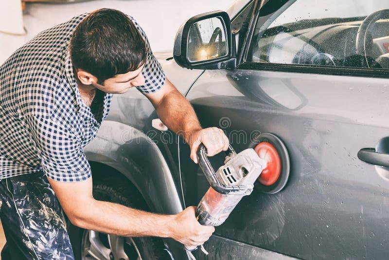 Auto mechanic polishing car stock image