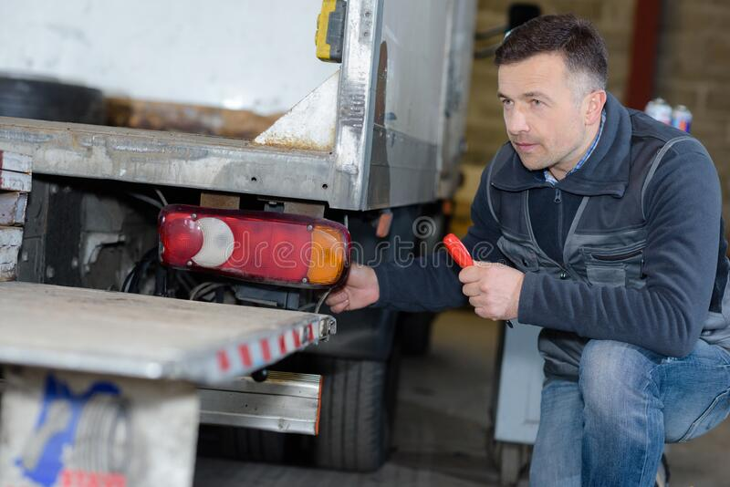 Auto mechanic repairing truck stock photo