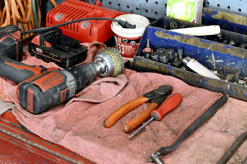 Auto Mechanic Tools on a Workbench with Pliers, Screwdriver, Wrench and Power Drill stock photo