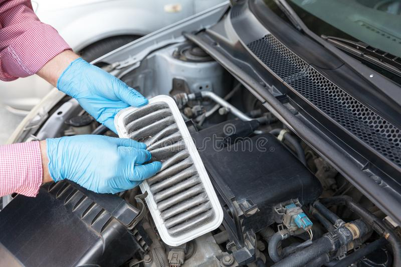 Replacement of a dirty car engine air filter royalty free stock photography